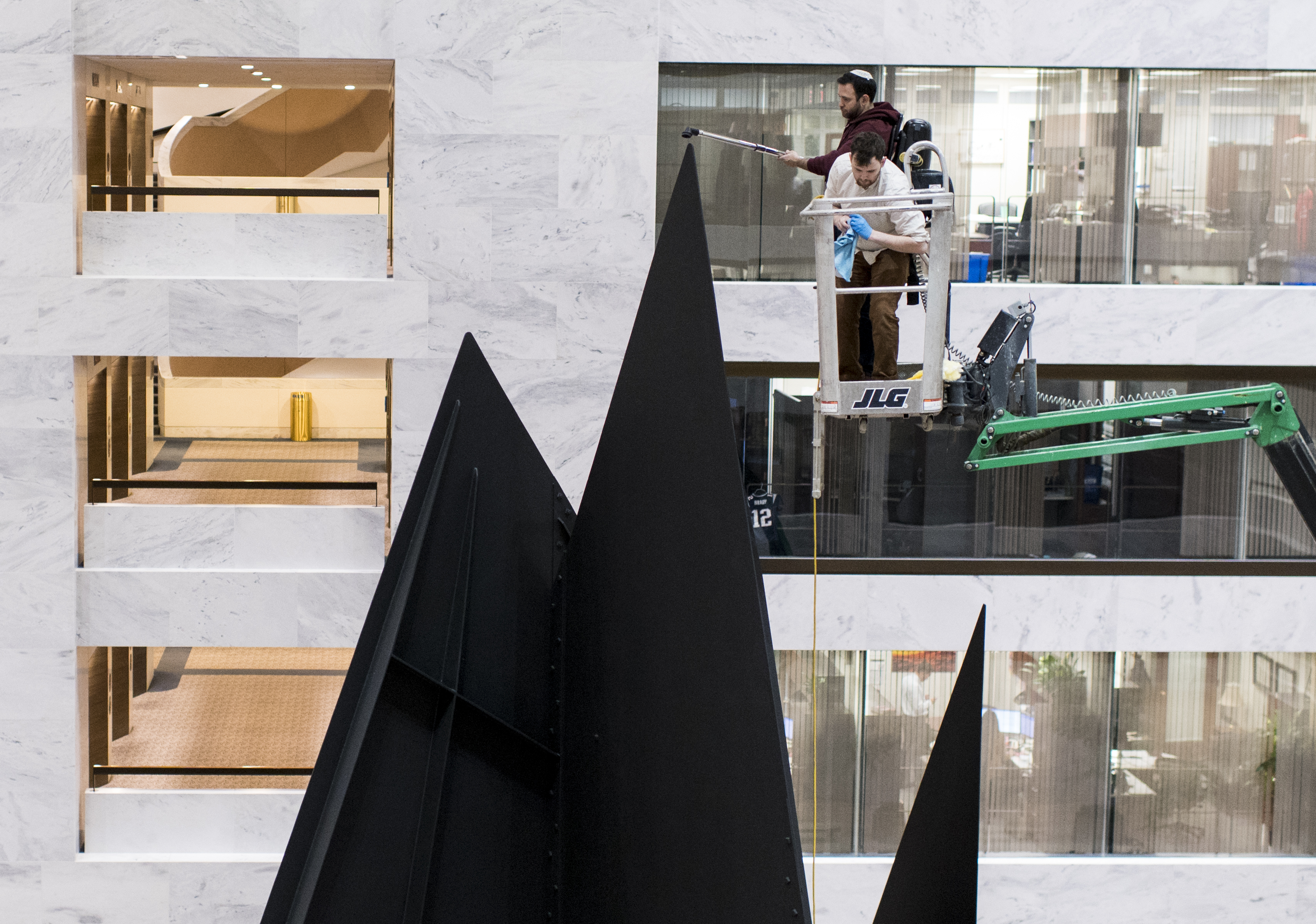 UNITED STATES - JANUARY 6: A work crew vacuums the peak of Calder's Mountains and Clouds intsallation in the atrium of the Hart Senate Office Building on Monday, Jan. 6, 2020. (Photo By Bill Clark/CQ Roll Call)