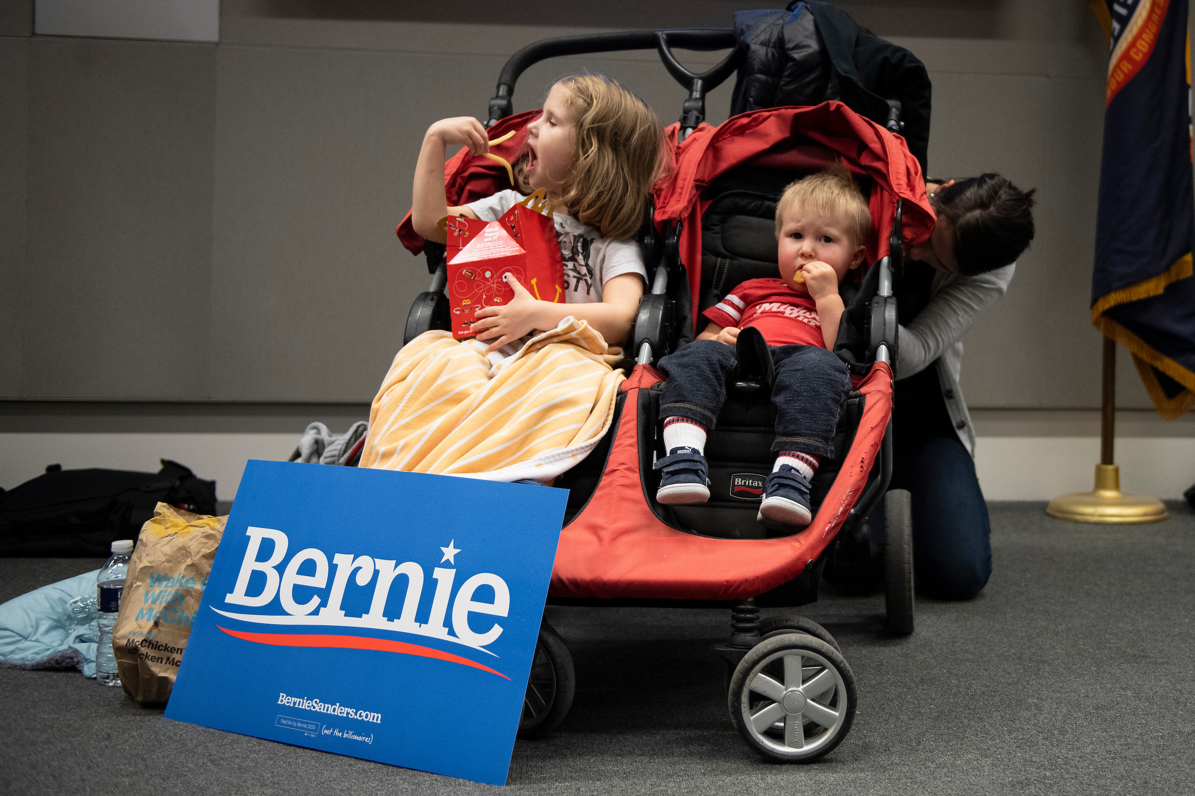 UNITED STATES - FEBRUARY 3: Aurelia Peterson, 3, left, and Jude Peterson, 1, eat food before the start of a Democratic satellite caucus at the International Brotherhood of Electrical Workers Hall on Monday, Feb. 3, 2020. (Photo by Caroline Brehman/CQ Roll Call)