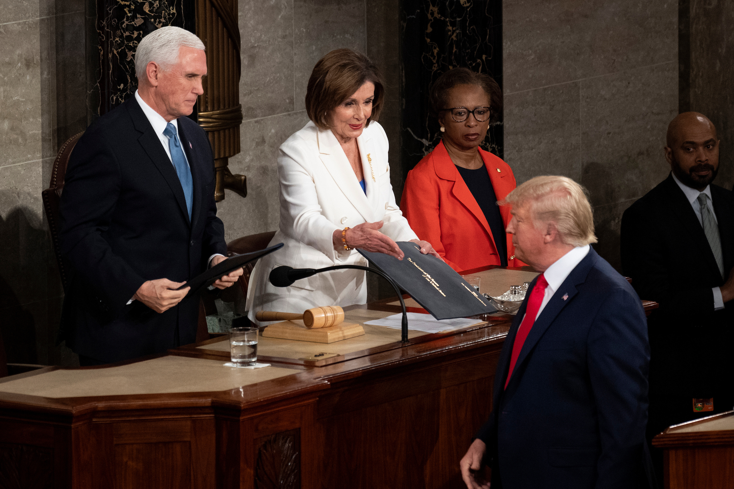 UNITED STATES - FEBRUARY 4: President Donald Trump turns away as Speaker of the House Nancy Pelosi reaches out to shake his hand as he arrives to deliver his State of the Union address to a joint session of Congress in the Capitol on Tuesday, Feb. 4, 2020. (Photo by Caroline Brehman/CQ Roll Call)