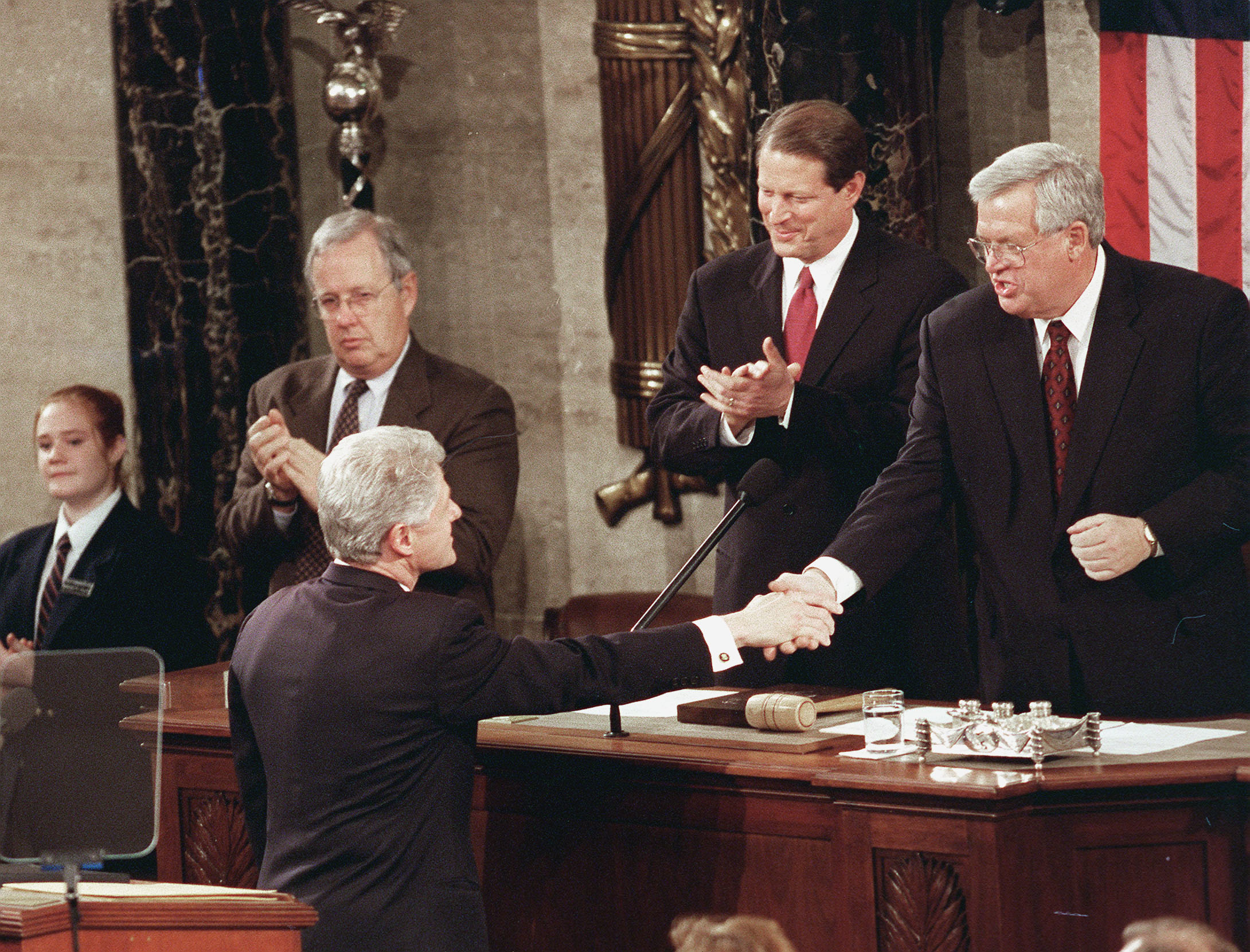 Before delivering his 1999 State of the Union address, President Clinton greets House Speaker J. Dennis Hastert,R-Ill., as Vice President Gore looks on. Douglas Graham/ CQ Roll Call file photo)