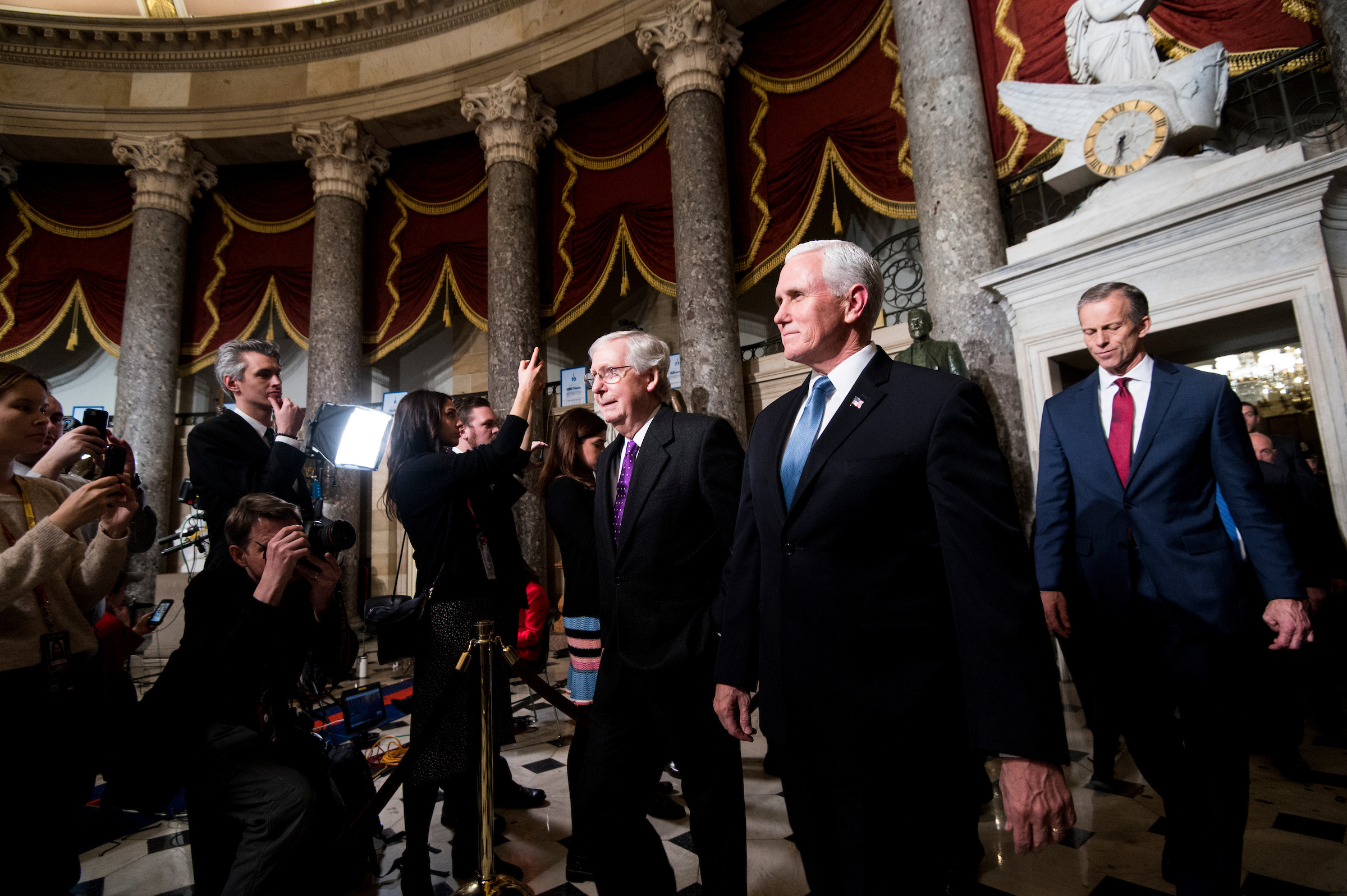 UNITED STATES - FEBRUARY 04: From left, Senate Majority Leader Mitch McConnell, R-Ky., Vice President Mike Pence and Sen. John Thune, R-S. Dak., walk through Statuary Hall to the House chamber before the start of President Donald Trump's State of the Union address on Tuesday, February 4, 2020. (Photo By Bill Clark/CQ Roll Call)