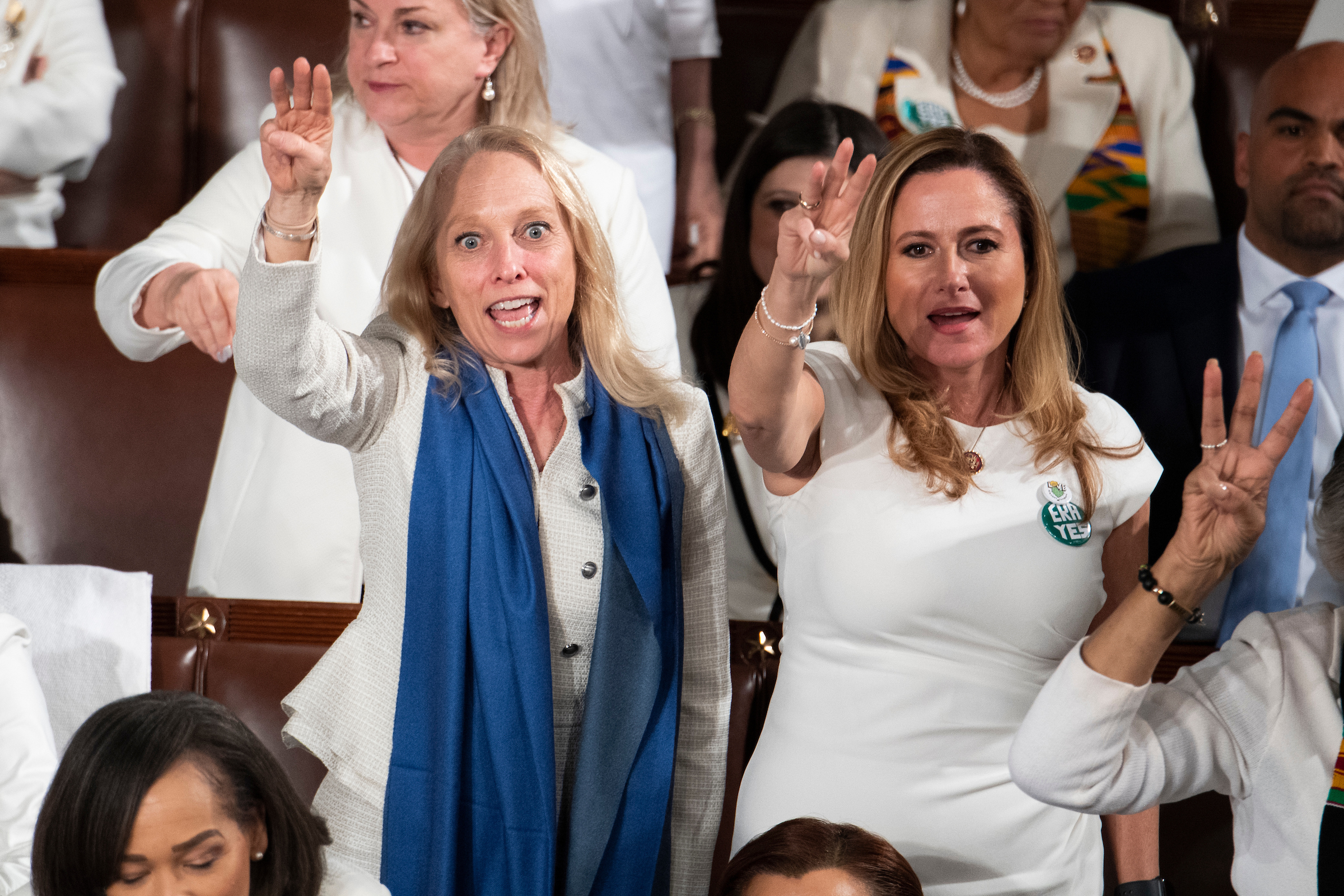 "UNITED STATES - FEBRUARY 04: Reps. Mary Gay Scanlon, D-Pa., left, and Debbie Mucarsel-Powell, D-Fla., right, chant ""H.R.3"" during President Donald Trump's State of the Union address in the House Chamber on Tuesday, February 4, 2020. The chants were in reference to the House-passed bill requiring the Medicare program to negotiate for lower drug prices. (Photo By Tom Williams/CQ Roll Call)"