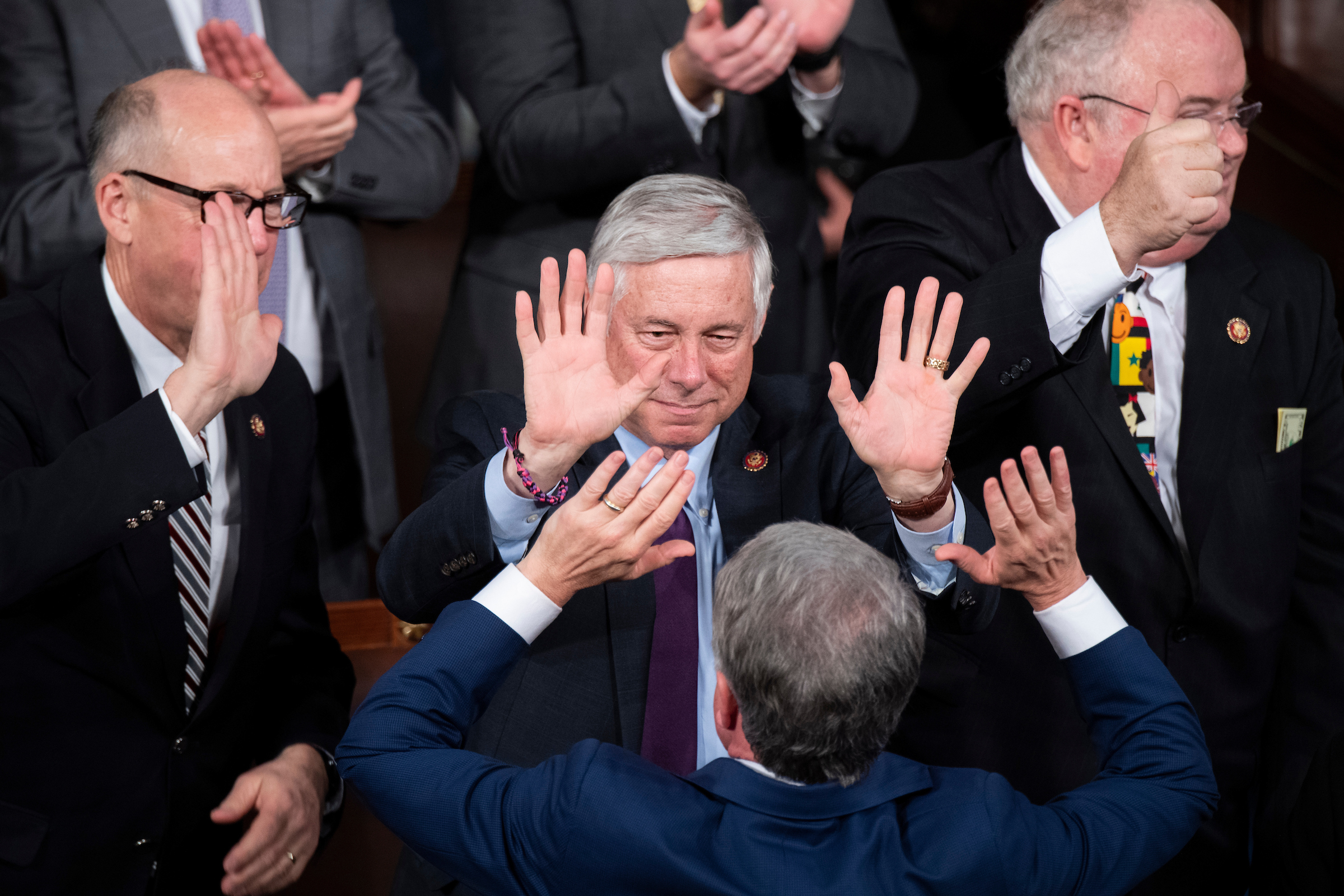 UNITED STATES - FEBRUARY 04: From left, Reps. Greg Walden, R-Ore., Fred Upton, R-Mich., Rep. Michael McCaul, R-Texas, high five during President Donald Trump's State of the Union address in the House Chamber on Tuesday, February 4, 2020. (Photo By Tom Williams/CQ Roll Call)