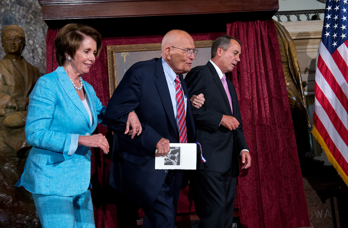 UNITED STATES - JUNE 13: Speaker John Boehner, R-Ohio, right, and House Minority Leader Nancy Pelosi, D-Calif., assist Rep. John Dingell, D-Mich., to his seat in the Capitol's Statuary Hall during a ceremony to honor Dingell as the longest serving member of Congress. He came to Congress in 1955, filling his father's seat. (Photo By Tom Williams/CQ Roll Call)