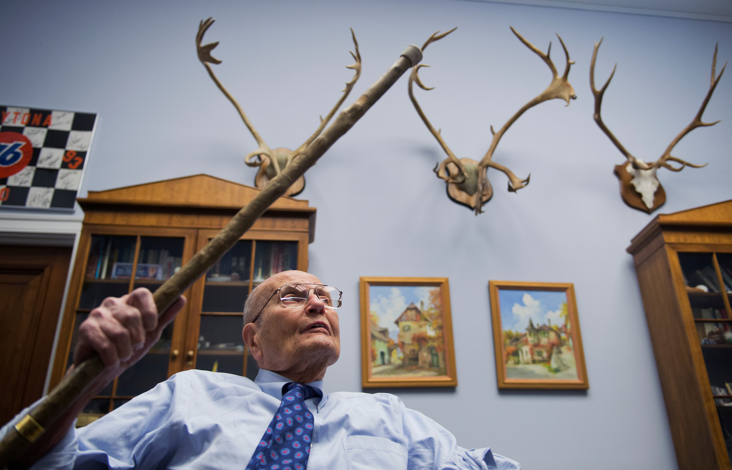 UNITED STATES - FEBRUARY 26: Rep. John Dingell, D-Mich., talks about memorabilia in his Rayburn office. (Photo By Tom Williams/CQ Roll Call)